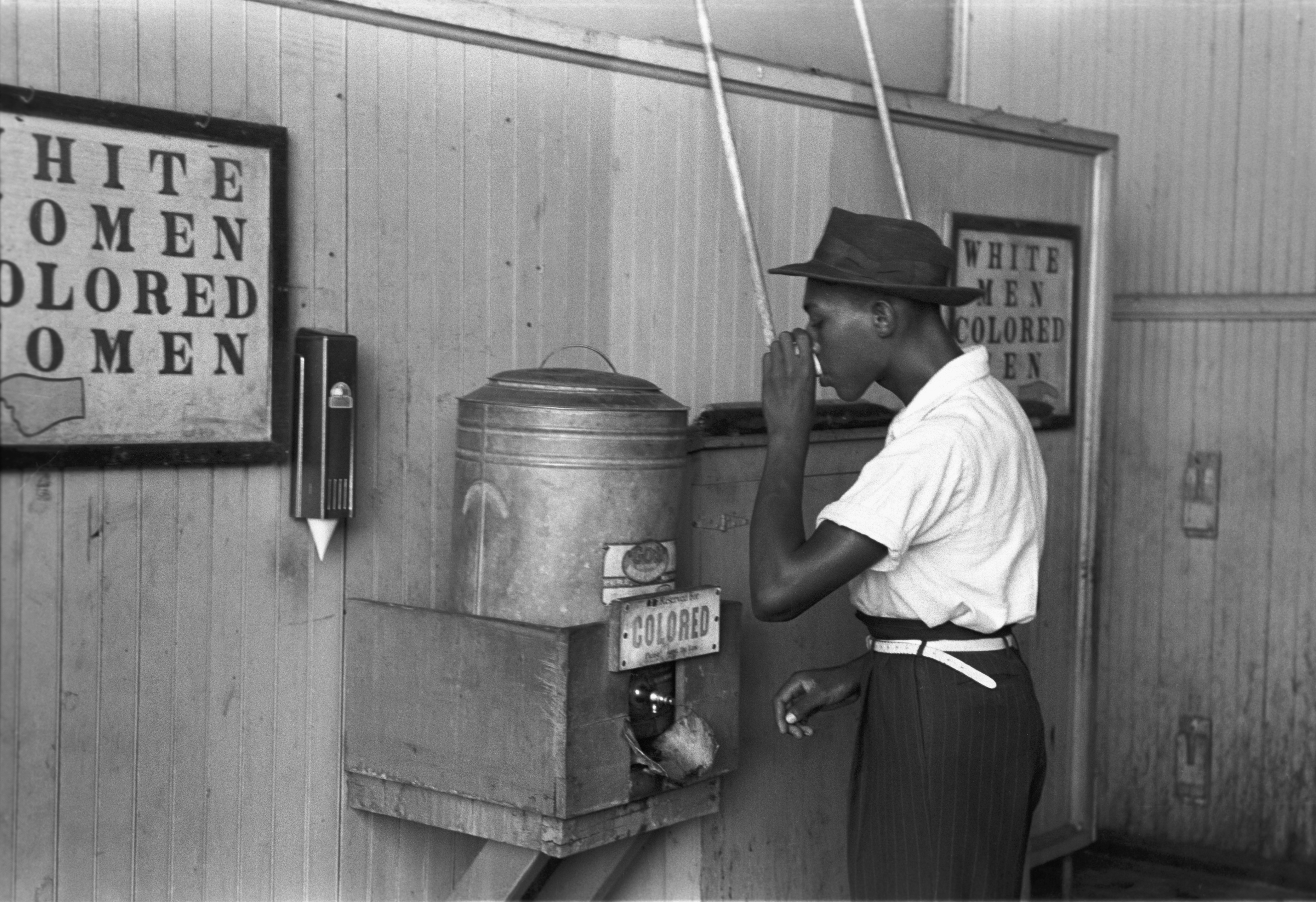 'Colored'_drinking_fountain_from_mid-20th_century_with_african-american_drinking