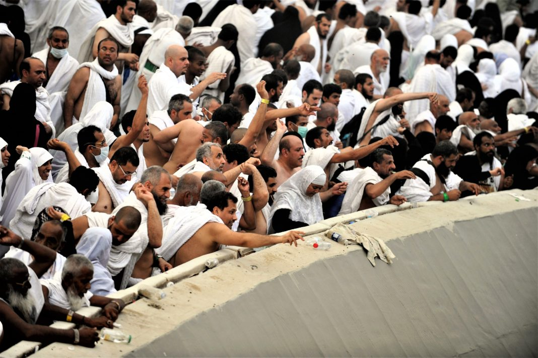 Muslim pilgrims throw pebbles at pillars during the